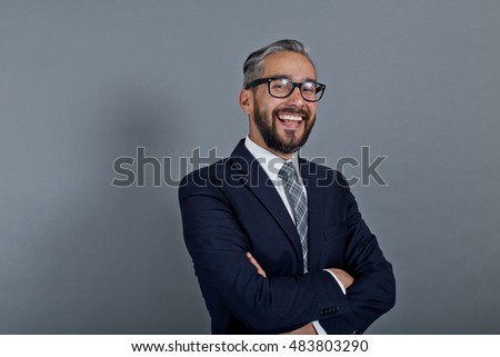 Happy latin man with suit