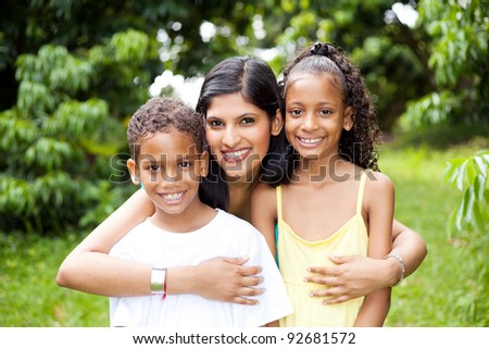 happy latin mother and kids outdoors - stock photo