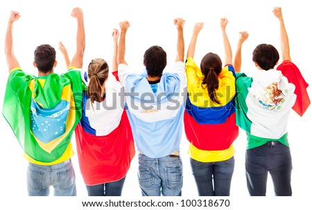Happy Latinamerican group with arms up ad flags - isolated over a white background - stock photo