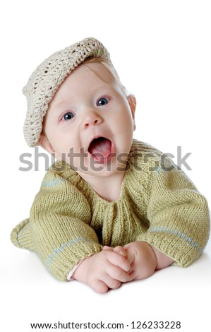 Happy laughing baby in a cap isolated on white background