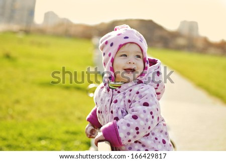 happy laughing baby  in the park
