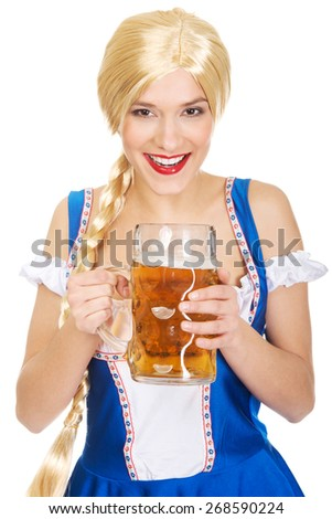 Happy laughing beautiful bavarian woman with beer. - stock photo