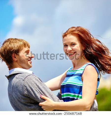 Happy laughing couple is hugging on Montmartre - stock photo