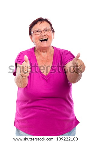 Happy laughing senior woman gesturing thumbs up, isolated on white background. - stock photo