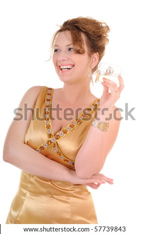 Happy laughing woman in gold dress with perfume bottle isolated on white background