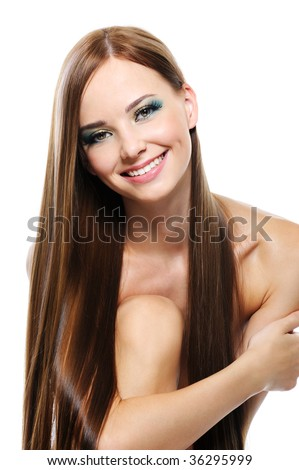 Happy laughing young girl with long beautiful straight hair