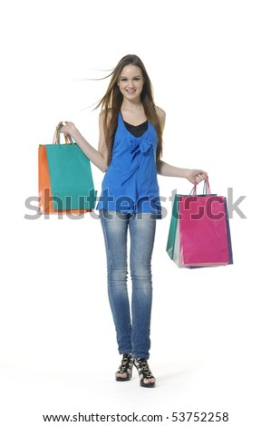 Happy laughing young woman with color bags - stock photo
