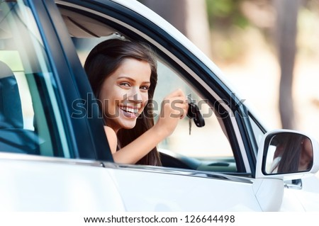happy learner driver young girl smiling portrait with car keys - stock photo
