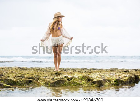 Happy lifestyle, Beautiful young woman outdoors at the beach. Soft warm colors.