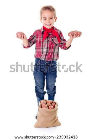 Happy little agriculturist showing good potato harvest - stock photo