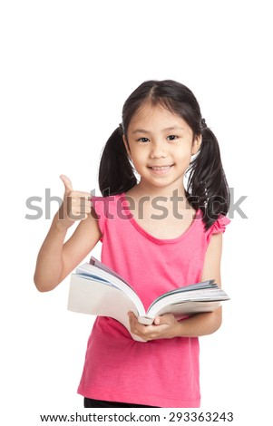 Happy little asian girl  read a book show thumbs up  isolated on white background