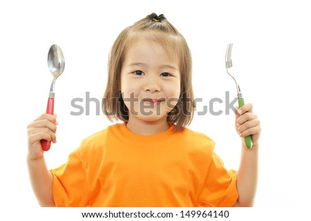 Happy little Asian girl smile - stock photo