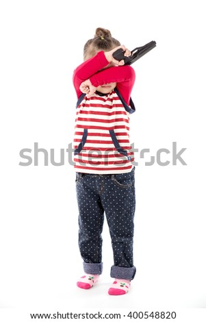 Happy little asian girl with a toy gun on white background