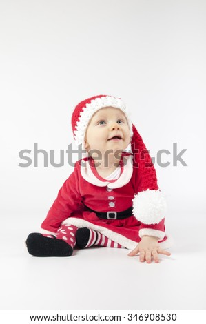 Happy little baby girl dress Santa clothes on white background. - stock photo