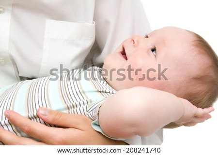 Happy little baby in mother's hands - stock photo