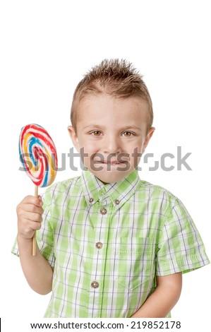 Happy little boy con lollipop - stock photo