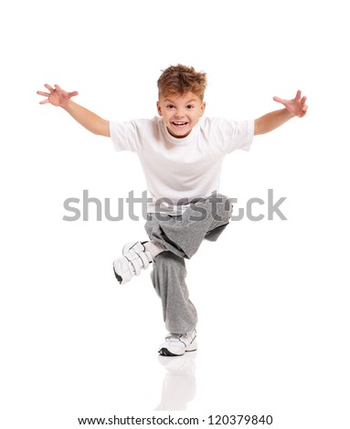 Happy little boy dancing isolated on white background