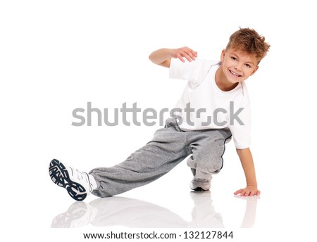Happy little boy dancing isolated on white background - stock photo