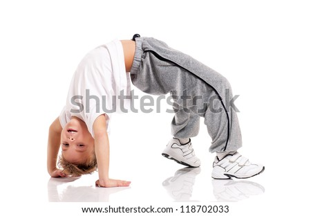 Happy little boy doing gymnastics isolated on white background