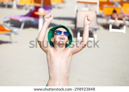 Happy little boy enjoying the summer holiday outdoor - stock photo