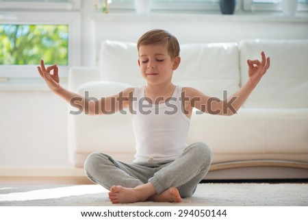 Happy little  boy exercising sport at home - stock photo