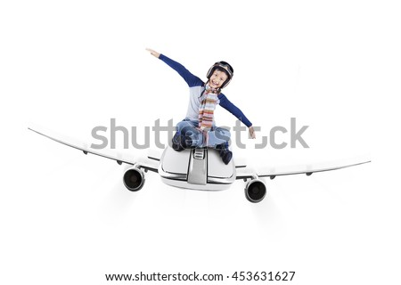 Happy little boy flying on the small airplane while wearing helmet, isolated on white background