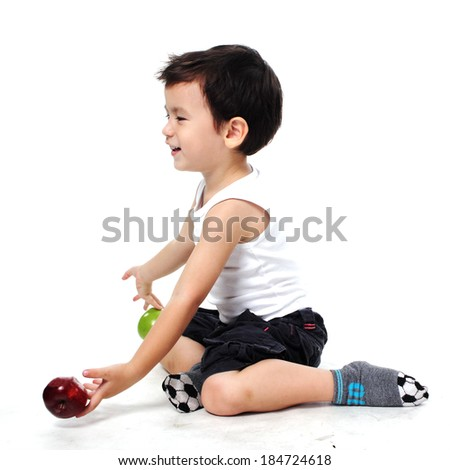 Happy Little boy holding apple isolated on white background