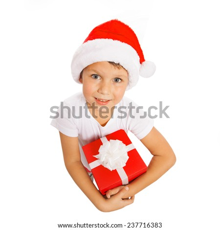 Happy little boy holding Christmas gift box in hand. Isolated on white background. Holidays, christmas, new year, x-mas concept.