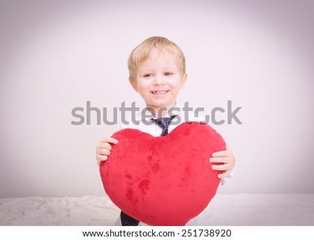 happy little boy holding heart, valentine concept - stock photo