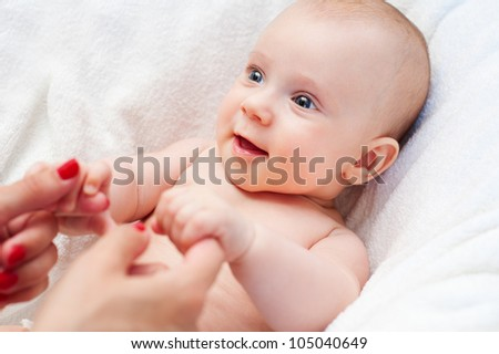 happy little boy holding mothers hands