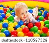 Happy little boy in colored ball. - stock photo