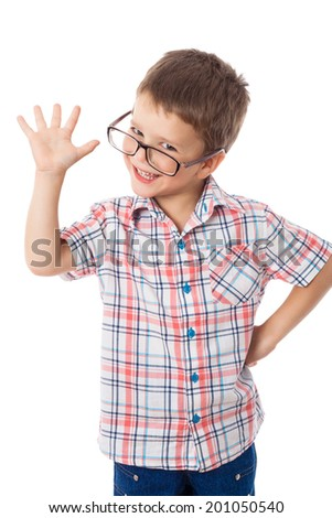 Happy little boy in glasses with greeting sign, isolated on white