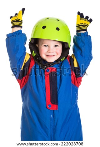 Happy little boy in winter sports overalls, isolated on white - stock photo