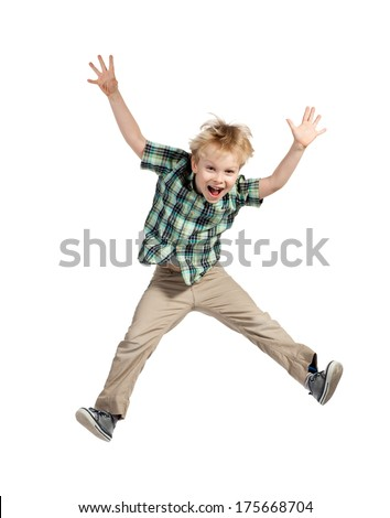Happy little boy jumping isolated on white background