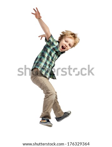 Happy little boy jumping isolated on white background - stock photo