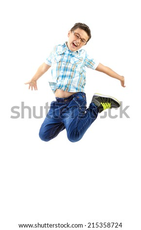 Happy little boy jumping on white background - stock photo