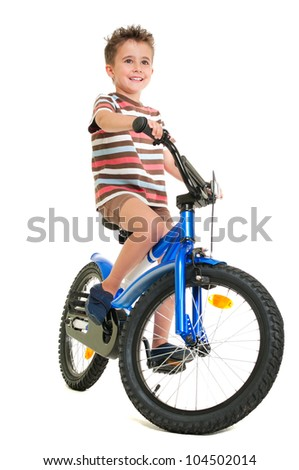 Happy little boy on bike  isolated on white