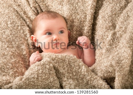 Happy little boy on blanket