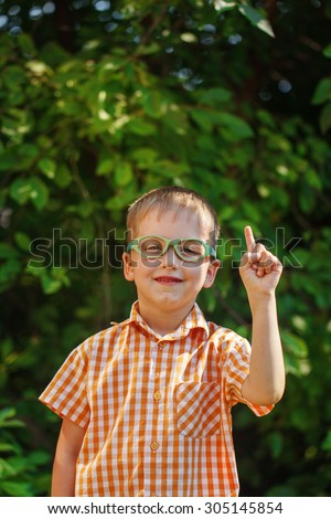 Happy little boy on his first day to school or nursery. Outdoors, Back to school concept - stock photo