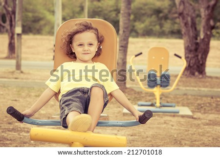 Happy little boy on the playground at the day time - stock photo