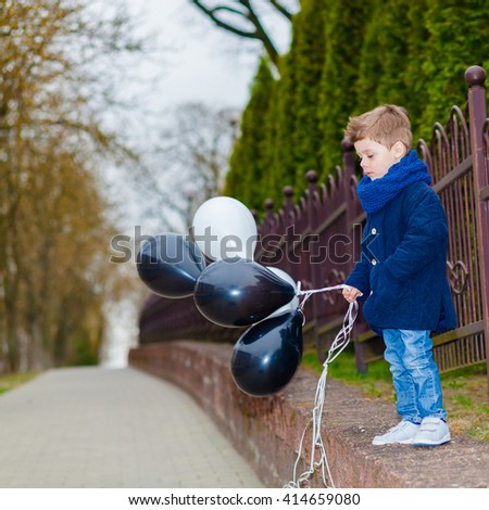 happy little Boy, outdoor. Trendy little boy with balloons