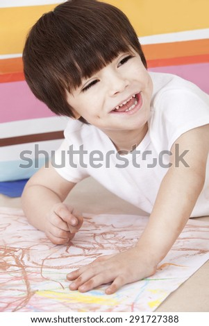 Happy little boy playing in kindergarten - stock photo