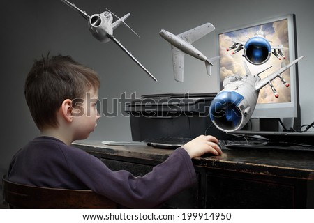 Happy little boy playing online pc game. Virtual reality concept.