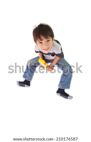 Happy little boy playing with building blocks on white background