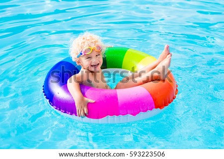 Happy Little Boy Playing Colorful Inflatable Stock Photo ...