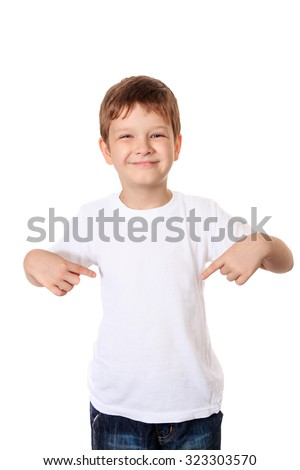 Happy little boy pointing his fingers on a blank t-shirt, a place for your advertising. Isolated in white. - stock photo