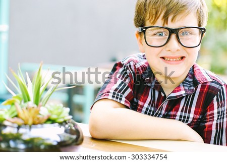 Happy little boy. Shallow depth of field - stock photo