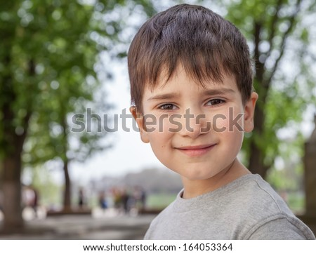 Happy little boy smiling on blurred background