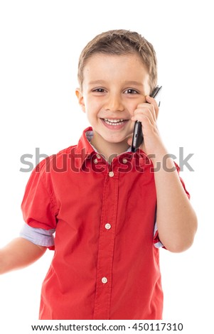 Happy little boy speaking on his smartphone over white background  - stock photo