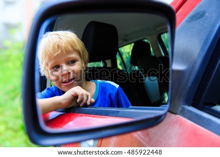 happy little boy travel by car